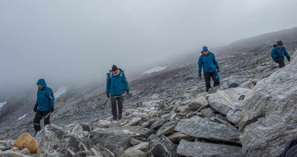 Archaeologists are surveying the scree at Lendbreen after the ice melted away.