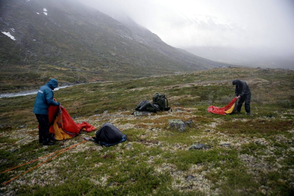 Reidar and Lars setting up the tents in the rain.